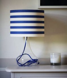 Made with striped wallpaper and a see-through lamp base. Lamp, Home Decor Inspiration, Wall Lamps Living Room, Decor, Diy Lamp, Nautical Lamps, Lighthouse Candle Holder, Lampshades, Home Decor