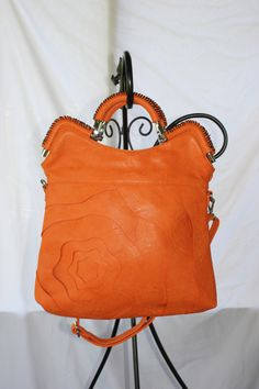 Alyssa Elite Handbag in Orange $70.00  Go to jtnmissions.org to order yours today!  100% of the proceeds go to missions local and worldwide.