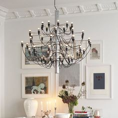 Chandelier Gino Sarfatti from Flos interior inspiration - Roomly.se