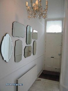 One large mirror can be very expensive. A cluster of small ones can be found at thrift stores and flea markets for next to nothing. Hallway Mirror, Mirror House, Mirror Mirror, Mirror Walls, Sunburst Mirror, Porch Storage, Storage Mirror, Old Mirrors, Vintage Mirrors