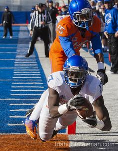 Boise State wide receiver Geraldo Bodewijn makes an acrobatic catch at the goal line defended by corner back Chaz Anderson to score a touchdown in the Broncos' spring scrimmage game Saturday April 13, 2013 at Bronco Stadium in Boise.