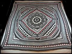 "Sophie's Universe 1 done in black, white, 2 shades of gray, and burgundy; 72"" square. (Pattern by Dedri Uys)"
