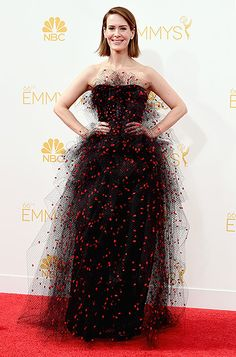 Sarah Paulson: 2014 Emmys The nominee looked ethereal in an Armani Prive gown with overlapping tulle and crimson silk tufts placed throughout.