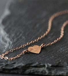 A little hammered heart is soldered into this 14K delicate rose gold chain. Simple yet a great addition to your favorite neutral outfit and your jewelry collection.