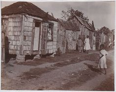 Photograph of housing and people in a 'slum' [Hyndman's Village]. Antigua, Catalogue reference: CO folio Crown Copyright. British Guiana, West Indian, Slums, Ancient Aliens, Virgin Islands, Sci Fi Art, Camps, Abandoned Places, Vintage Photos