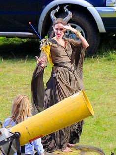 GREENER PASTURES    Angelina Jolie continues to channel her inner evil sorceress Tuesday on the set of Maleficent in Buckinghamshire, England.
