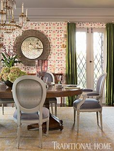 Emerald-green curtains mix playfully with a patterned wallpaper from Idarica Gazzoni. - Traditional Home ® / Photo: Karyn Millet / Design: Joe Lucas and Parrish Chilcoat