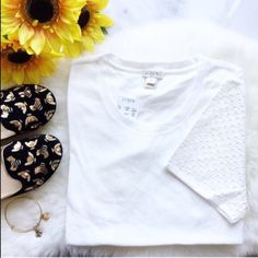 ⚬J. Crew⚬Ivory Eyelet Tee This gorgeous and classy tee is a wardrobe essential. Great on its own, or layered during cooler months, this top will always be in style. Ivory with beautiful eyelet sleeve detail. Brand new, never worn. XS but could easily fit a small. I do bundle discounts! ❣PLEASE DO NOT PURCHASE THIS LISTING❣ Let me know when you're ready to buy and I will create a listing for you. J. Crew Tops Tees - Short Sleeve