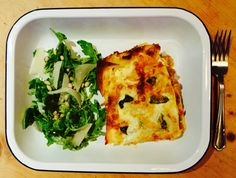 Lasagna; beef mince, celery, carrot, onion, garlic, rosemary, Worcester, red wine, veal stock; béchamel with mascarpone, pecorino, Parmesan, nutmeg. With buffalo mozzarella and basil. Served with rocket salad with Parmesan & pinenuts.