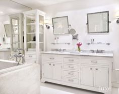 Create Photo Gallery For Website A modern all white master bathroom reflects a light and bright aesthetic with a vanity by Restoration Hardware and floors from Opustone Samuel Heath