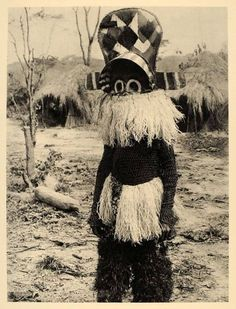 Africa | masked Ngangela dancer, Angola, c. 1930.