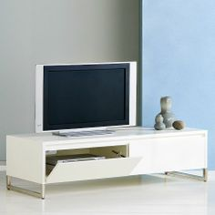 This is the one that fit and looks great    A mix of wood and metal make for a clean, functional design, with a long, low-slung presence, roomy drawers for all your storage essentials and narrow metal legs that lighten the look. The console is the perfect height for watching television, and the flip-down doors offer easy access to all media components.