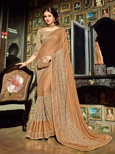 Perfect for special occasion, this brown color jacquard fancy designer saree is an ultimate inclusion in your ethnic wear collection. The floral embroidery work further make the saree look absolutely gorgeous. Raw Silk Fabric, Satin Saree, Silk Sarees, Designer Sarees Online, Saree Look, Party Wear Sarees, Indian Outfits, Indian Clothes, Festival Wear