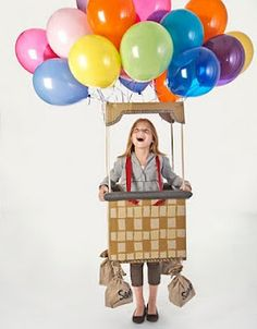 Hot Air Balloon costume:  Balloons, Box, Dollies, String, Sacks, Little decorations to dress up the basket.
