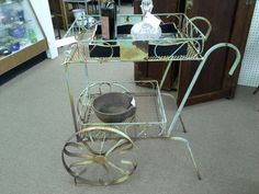 """$175 - This vintage rusty shabby iron serving cart is from Banfi Vintners in Tuscany Italy area. It has two expanded metal serving areas and is on large iron wheels for easy moving. It measures approximately 35"""" x 21 1/2"""" x 36"""". It can be seen in booth B12 at Main Street Antique Mall 7260 East Main Street ( E of Power Rd ) Mesa, AZ 85207 480 9241122open 7 days a week 10a.m to 5 : 30p.m Cash, charge or 30 day layaway accepted"""