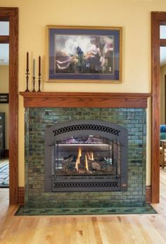 The two sided fireplace allows the home owner to set the tone for two rooms with one wall between them. The home owner wanted one for the dining room and on the other side have a reading room for after dinner tea and cookies. There is no better way to live than handmade tile and great food. Colors: Pesto and Jade Moss.