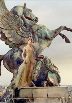 Natalia Vodianova in a Donna Karan gown photographed on the Paris Opera roof...by Annie Liebovitz