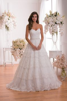 Jasmine Collection Wedding Dress Style F171020 in Ivory-Ivory. A timeless and classic dress with a modern touch with its strapless sweetheart neckline. This tulle wedding gown has a ball gown skirt with luxuriously layered Alençon lace. This gown is luxurious, elegant, and timeless all at once.
