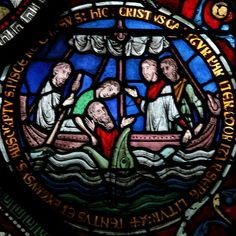 """Medieval stained glass depiction of Jonah being swallowed by the whale, as an Old Testament """"type"""" for the Entombment of Christ. Corona Redemption Window , c.1200-07."""