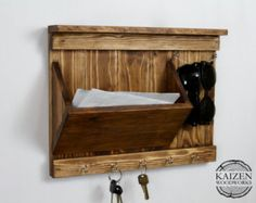 Hand made organizer for your entryway. The features include a mail holder for business sized envelopes and smaller, 3 dual prong hooks to hold keys and other items, and a line to hang sunglasses on. The approximate size is 11.5 tall x 15.25 wide, contact me if youre interested in different dimensions and I will get you a quote.  You get to choose from 6 different stains on the finished look: Aged White, Light Gray, Naturally Aged, Dark Gray, Rustic Brown, and Espresso. The final color can…