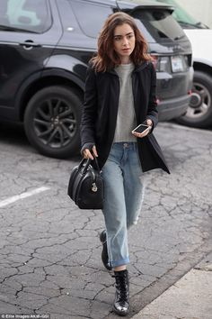 Mom jeans: Lily Collins stepped out in high-waisted denim and steel-toed boots on Monday for a solo lunch outing in Los Angeles