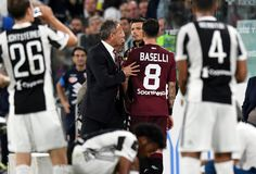 Sinisa Mihajlovic head cach of Torino FC and Daniele Baselli of Torino FC during the Serie A match between Juventus and Torino FC on September 23, 2017 in Turin, Italy.