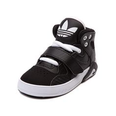 Shop for Toddler adidas Roundhouse Athletic Shoe in Black at Journeys Kidz. Shop today for the hottest brands in mens shoes and womens shoes at JourneysKidz.com.The Roundhouse mid-cut athletic shoe from adidas is now available for little feet! Classic b-ball style, it features a mixed leather upper, midfoot hook and loop strap across the laces, and EVA midsole to keep his feet comfortably supported. Exclusive edition black colorway with white contrast. Available only at Journeys Kidz!