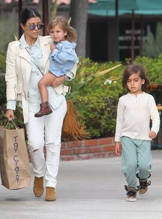 On-the-go momma Kourtney Kardashian, flaunting round sunnies with flash lenses, took two of her kiddies toy shopping in Malibu!