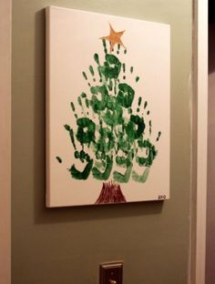 Christmas tree handprint on canvas.  I'm going to do this with Will and Ellie, but also do fingerprints as lights on the tree in bright colors.