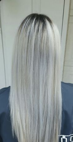 Dark shadow root, Platinum white blonde hair with blue tones. By Amanda. Redken Shades EQ 09b