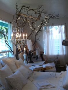 lights and tree branches on white... This looks so cozy!