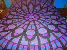 I think this is stunning.  Stained glass crochet blanket
