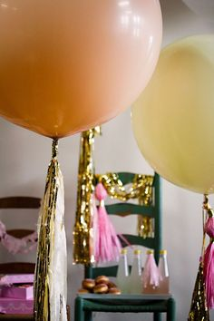 Big balloons with gold tassels and ribbon... Looks so festive!