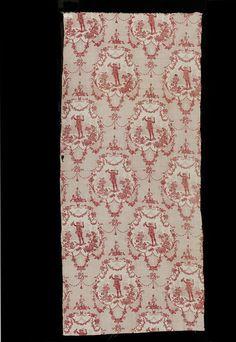 Petit buveur, 1784, fragment d'une toile de coton imprimée à la planche de bois. Motif inspiré de Watteau, dans des médaillons entourés de guirlandes de fleurs. Conservé au V&A (Londres), T.97-1980.