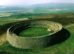 The Grianan of Aileach is an Iron Age stone fortress that was occupied from about 800 BC till about 1200 CE. According to legend, it was built by the renowned Kind Daghda of the Tuatha de Danann. Supposedly, the king's son Aeah was buried in the center of the fortress.