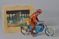 Lehmann - Echo Motorcycle with Rider, Number EPL 725, with Original Box. Painted Tinplate with Coil-Spring Mechanism. Brandenberg, Germany. Circa 1917-1935. 18.5cm x 22cm.