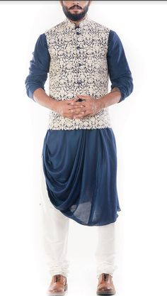 Featuring a royal blue cowl drapped kurta with a cream waistcoat and white churidar. The jacket has beautiful dori embroidery on it. Wedding Dresses Men Indian, Wedding Dress Men, Wedding Suits, Wedding Wear, Wedding Attire, Wedding Updo, Nehru Jacket For Men, Nehru Jackets, Men's Jackets