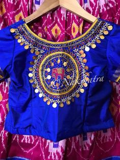 Beautiful royal blue color designer blouse with elephant motif hand embroidery thread work. Blouse with kasu work.