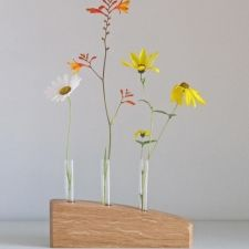 3 STEM FLOWER VASE IN OAK - A simple stylish flower stem vase hand crafted in Oak. This contemporary vase is a great way to have an exuberant display of flowers using only a few stems. I make each vase from an individual piece of wood, hand finished with natural oils to protect it and bring out the natural markings in the timber. A completely unique gift for a wedding, birthday or Christmas, or just a personal indulgence! £35.00 David Ames, Contemporary Vases, Flower Vases, Flowers, Natural Oils, Stems, Glass Vase, Unique Gifts, It Is Finished