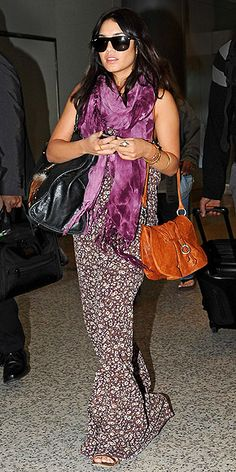VANESSA HUDGENS  After wearing gold on the red carpet, the actress returns to her boho-chic – and comfy! – roots in a floral Blu Moon maxi, tie-dye scarf and long-strap purse before departing Melbourne, Australia.