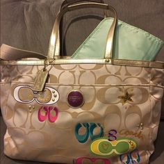 "COACH Sig ""C"" Gold Poppy Diaper Bag ✨STILL AVAILABLE ✨ Purchased from COACH in 2011. Bag exterior is gorgeous gold sateen canvas with multi-colored and sequin embellishments. Interior is lined with mint-green satin and features cell phone pocket, interior zippered pocket and several other multi-purpose pockets. Also has zippered pocket in back. VERY MINOR signs of wear (see pics). Hand-laundered with Coach fabric cleaner and oxiclean (for milk stains). Dust bag included. Coach Bags Baby Bags"