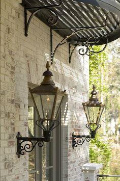 metal awning with gas lanterns