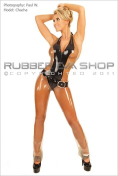 """This is a beautifully designed rubber catsuit to fit every curve. Multi-panelled in either all one colour or two-toned as pictured. The low cut """"V"""" front plunges down and is shaped for a wonderful cleavage. The halterneck fastens at the back with 3 metal poppers. It has a 3-way through crotch back zip and slightly flared bootleg trouser. This amazing colour choice of Transparent Cloud with a Black front panel is daring but covers up all the naughty bits......Just !!"""