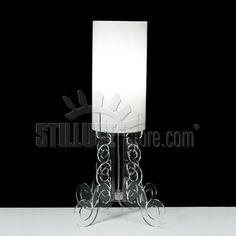 Emporium Truciolo Grande  lampada tavolo con paralume in metacrilato, opal diffusore. Particolari di fissaggio in metallo verniciato lucido. Base in metacrilato disponibile nei colori trasparente, bianco satinato, nero.
