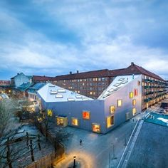 Children's+centre+with+a+dipping+roof+by+Dorte+Mandrup+encloses+a+Copenhagen+courtyard