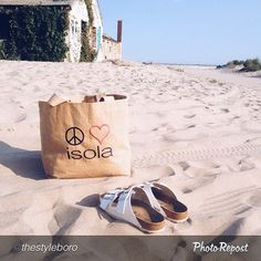 Thank you @thestyleboro for capturing this fabulous shot! Nothing like a summer day with great style! #repost #style #fashion #burlap #burlapbag #isola #isolabody #peace #love #summer #beach #island #august #accessory #sand #relax #books #breeze #skincare #Jute #tote #island #nofilter