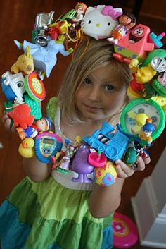 Totally cute idea to do something with all those small sentimental kid toys that you don't want to get rid of and then hang it in the playroom. :)