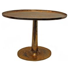 Tall gilt oval side table with tulip base.