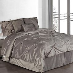 The sleek style of the Pintuck Plush Comforter Set is filled with chic accents made up of individually sewn pintucks across the comforter. Add a touch of understated charm to your bedroom with this comfortable set.