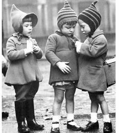 parcel tag brown...for name evacuee...cardboard box gas mark...hand knitted wool hats.wellies..patent shoes.shiny..mittens string up arms ho...